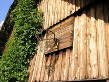 Rural Basketball. A rusty basketball loop attached to a selfmade wooden board on an old wooden barn wall somewhere in the countryside Stock Images