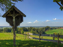 Rural bavarian landscape with wayside cross Stock Photography