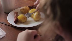 Rural breakfast from baked potato and sausages stock video footage