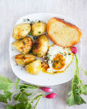 Rural breakfast - fried eggs, new potatoes, radish Stock Photo