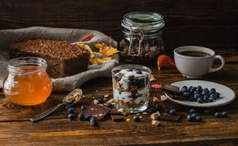 Rural Breakfast with Granola and Blueberries Stock Photos