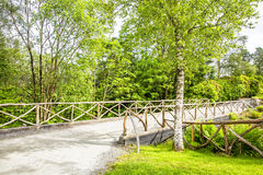 Rural bridge and old fence in summer sunny day. Royalty Free Stock Image