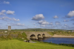 Rural bridge over water. With castle and blue sky Stock Photography