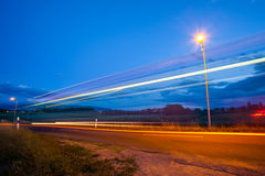 Rural bus light trail. A rural bus moving on an empty rural street Stock Photos