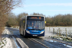 Rural bus service in winter on slippy road. Stock Images