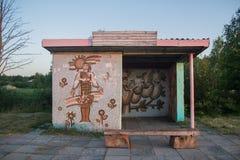 Rural bus stop shelter near village Stock Photo