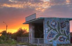 Rural bus stop shelter near village royalty free stock image