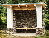 Rural bus stop of stone and wood Stock Image
