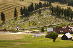Rural cemetery. Rows of graves Royalty Free Stock Photography