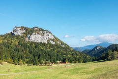 Rural chalet under amazing limestone rock hill Stock Images