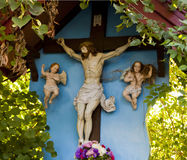 Rural chapel with crucifix and angels Stock Photos
