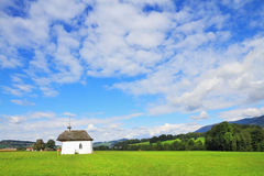 The rural chapel on a green meadow Royalty Free Stock Image