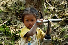 Rural Child. January 21,2013 Medinipur,West Bengal,India,Asia-A rural child try to press a water tubewell Royalty Free Stock Photo