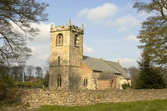 Rural church. And dry stone wall Royalty Free Stock Photo