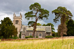 Rural Church. An old english church on a hillside on a stormy summer day Stock Photos