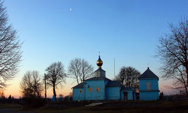 Rural church. Rural wooden St. Nicholas church in the Ukrainian village Smolyhiv at dawn Stock Image