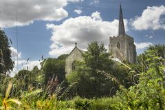 Rural church. Rural english church with cloudy blue sky royalty free stock photography