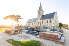 Rural church and cemetery at sunset in Normandie, France. Church and cemetery at sunset at the countryside in Normandie, France Stock Photography