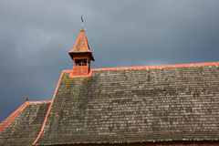 Rural Church in the Chilean Lake District. Tiled roof of a small church in farmland surrounding Lake Llanquihue in the Lake District of southern Chile Royalty Free Stock Photo