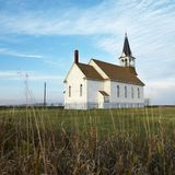 Rural church in field.