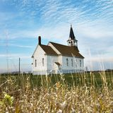 Rural church in field. royalty free stock photos