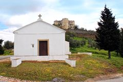 Rural church in front of castle, Evoramonte Royalty Free Stock Images