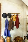 Rural Cloakroom with Clothes Royalty Free Stock Image