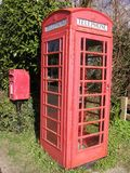 Rural communication. Telephone box and post box in rural english village becoming part of a bygone age stock photo