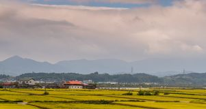 Rural community under a cloudy sky Stock Images