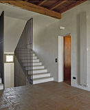 Rural concrete staircase. With iron banisters and terracotta floors Royalty Free Stock Photography