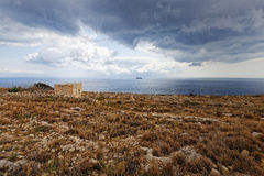 Rural cottage on the cliff of Mnajdra, Hagar Qim (super wide) Royalty Free Stock Images