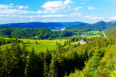 Rural cottage in the mountains and green meadow. . Slovakia. Royalty Free Stock Photography