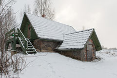 Rural cottage in winter in countryside Royalty Free Stock Photo