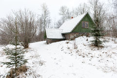 Rural cottage in winter in countryside Royalty Free Stock Photography