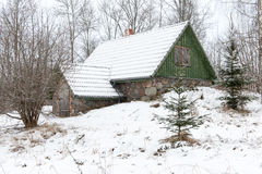 Rural cottage in winter in countryside Royalty Free Stock Photos