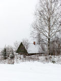 Rural cottage in winter in countryside Stock Image