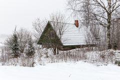 Rural cottage in winter in countryside Royalty Free Stock Image