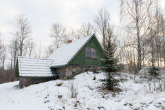 Rural cottage in winter in countryside Royalty Free Stock Images