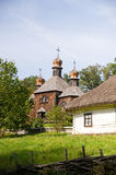 rural cottage and wooden church Stock Photos