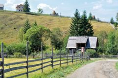 Rural country road fence landscape, Dirt road and wooden fence in a village. In Romania royalty free stock images