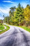 Rural country road new england. A rural road by farm land within the new england town of cornwall connecticut on a blue sky day royalty free stock photo
