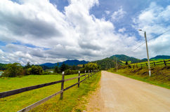 Rural Country Road. And wooden fence in Neusa, Colombia Royalty Free Stock Photos