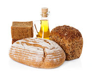Rural country still life. Bread, sunflower oil Royalty Free Stock Photos