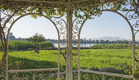 Rural countryside view of a river in summer through trellis Royalty Free Stock Photos