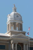 A rural, county courthouse. The dome of a rural county courthouse rises against a clear blue sky Stock Photo