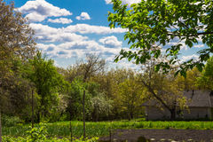 Rural croft overlooking the garden in spring Royalty Free Stock Image