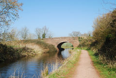 Rural Devon canal scene with bridge. Towpath and landscape at Great Western Canal Devon Stock Images
