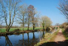 Rural Devon canal scene with bridge. Towpath and landscape at Great Western Canal Devon Stock Image