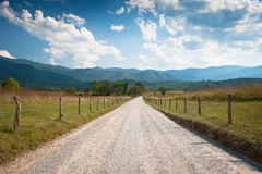 Rural Dirt Road Farm Landscape in Cades Cove. TN through summer hay fields Stock Photos
