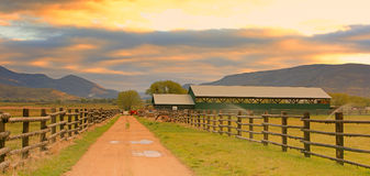 Rural dirt road and fence. Stock Photo